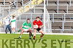 Daniel Griffin Glenbeigh/Glencargets to the ball ahead of Jeremiah Hoare Na Gaeil during the Junior Premier final in Fitzgerald Stadium on Sunday