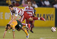 Mark Wilson falls over Pete Vagenas after a header in the US Open Cup at the Home Depot Center, in Carson, Calif., Wednesday, September 28, 2005.
