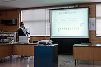 Nobuhiro Suzuki, the CEO of Rakuou Milk products factory gives a presentation showing how the events of March 11th 2011  after sales of Fukushima dairy products. Koriyama, Fukushima, Japan Sunday November 22nd 2015
