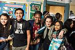 group of high school students posing in corridor.