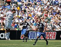 LA's Ante Jazic (4) heads the ball over San Jose's Arturo Alvarez (17).San Jose Earthquakes defeated LA Galaxy 3-2. August 3, 2008, McAfee Coliseum, Oakland, CA.