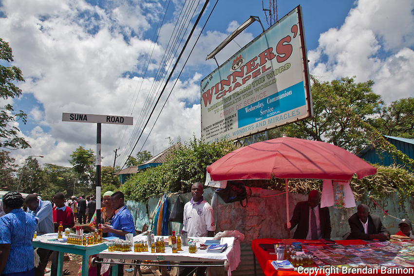 Vendors selling  annointing oils and religious literature outside of Nairobi's Winner's Chapel, a fast growing evangelical Christian Church, founded in Nigeria.