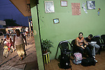Sharon and Marjorie Reyes wait for their bus to return to San Pedro, Honduras, at a bus office in Tecun Uman. They wait for 8 hours in the office because the city is dangerous at night..