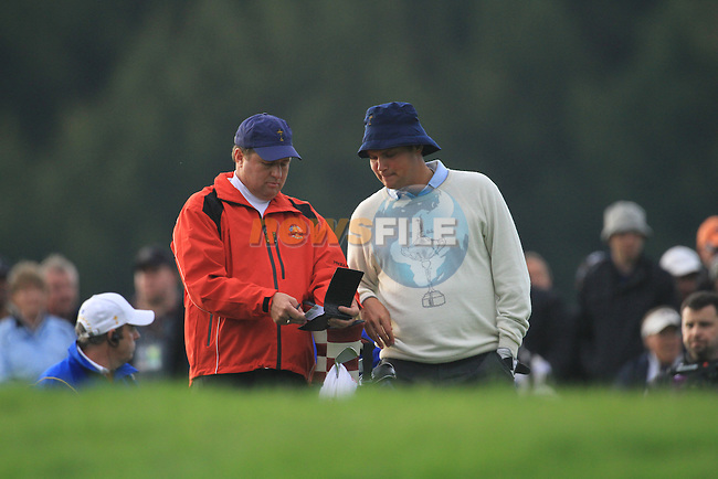 2010 Ryder Cup at the Celtic Manor twenty ten course, Newport Wales, 1/10/2010 on day one of play After play restarted at 5 pm..Jeff Overton playing his second shot on the 5th..Picture Fran Caffrey/www.golffile.ie.
