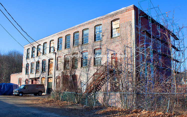 WINSTED CT- DECEMBER 13  2012 -121312DA10- The former Winsted Furniture building at 10 Bridge St. in Winsted is now the Complex Mad River Lofts which is in the works of being renovated for possible artist studios, high-end tech offices, light manufacturing and restaurants..Darlene Douty Republican American