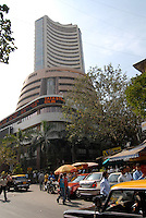INDIA, Mumbai, stock exchange in Dalal Street, news ticker BSE Bombay Stock Exchange index, notation of TATA Motors and TATA Steel / INDIEN, Mumbai, indische Boerse
