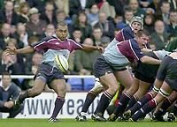 Photo - Peter Spurrier.25/01/03.Powergen Cup Quarter Final London Irish v Rotherham.Rotherham scrum half, Jacob Rauluni, kick's clear from behind the scrum..
