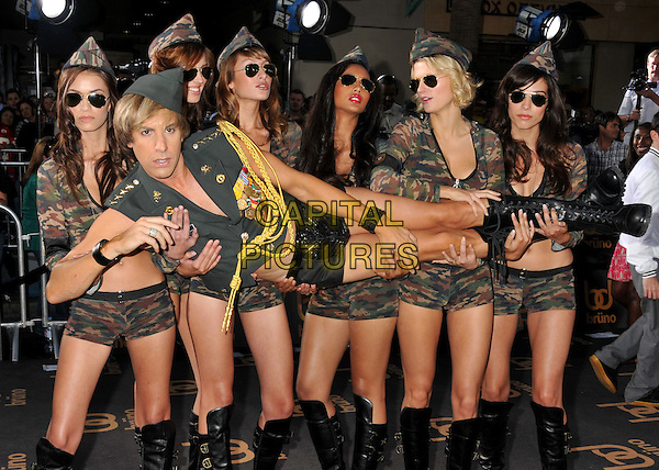"SACHA BARON COHEN.""Bruno"" Los Angeles Premiere held at Grauman's Chinese Theatre, Hollywood, CA, USA..June 25th, 2009 .full length army green uniform military lifting carrying girls sunglasses shades black shorts camouflage hat.CAP/ADM/BP.©Byron Purvis/AdMedia/Capital Pictures."