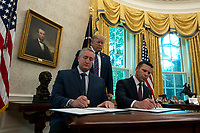 Acting United States Secretary of Homeland Security Kevin McAleenan and Guatemalan Minister Enrique Degenhart sign the Safe-Third Agreement in the Oval Office of the White House in Washington D.C., U.S. on July 26, 2019. Photo Credit: Stefani Reynolds/CNP/AdMedia