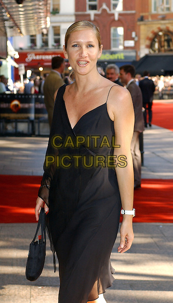 "TANIA BRYER.""War of The Worlds"" UK Premiere.June 19th, 2005.half length black dress black purse funny face.www.capitalpictures.com.sales@capitalpictures.com.© Capital Pictures."