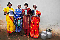 The barefoot solar engineers: (from left to right) Talsa Miniaka (37), Pulka Wadeka (36), Minakshi Diwan (20), and Bundei Hidreka (31). The Orissa Tribal Empowerment and Livelihoods Programme (OTELP) is an organisation funded by DFID (Department for International Development) and run with the state government of Orissa. The project took four women from a remote tribal village and trained them in Solar Powered Engineering, and installed solar lighting in their village which had not seen electricity for over 15 years. The Orissa Tribal Women's Barefoot Solar Engineers Association has now got a contract to build 3,000 solar-powered lanterns for schools and other institutions and is training other people in the community...