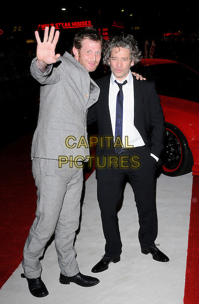 "JASON FLEMYNG & DEXTER FLETCHER .The European Premiere of ""Kick-Ass"", Empire Leicester Square, London, England, UK..22nd March 2010.arrivals full length black grey gray hand arm palm suit.CAP/CAN.©Can Nguyen/Capital Pictures."
