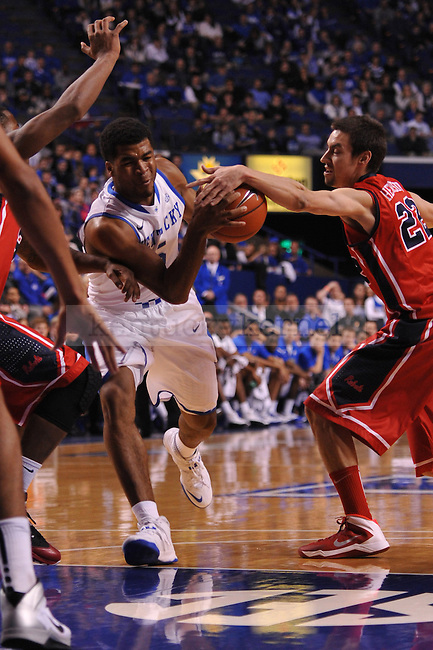 UK guard Andrew Harrison (5) dribbles to the basket while Ole Miss guard Marshall Henderson (22) tries to knock it out of his hands during the first half of the UK men's basketball team vs Ole Miss at Rupp Arena in Lexington, Ky., on Tuesday, February 4, 2014.  Photo by Eleanor Hasken | Staff