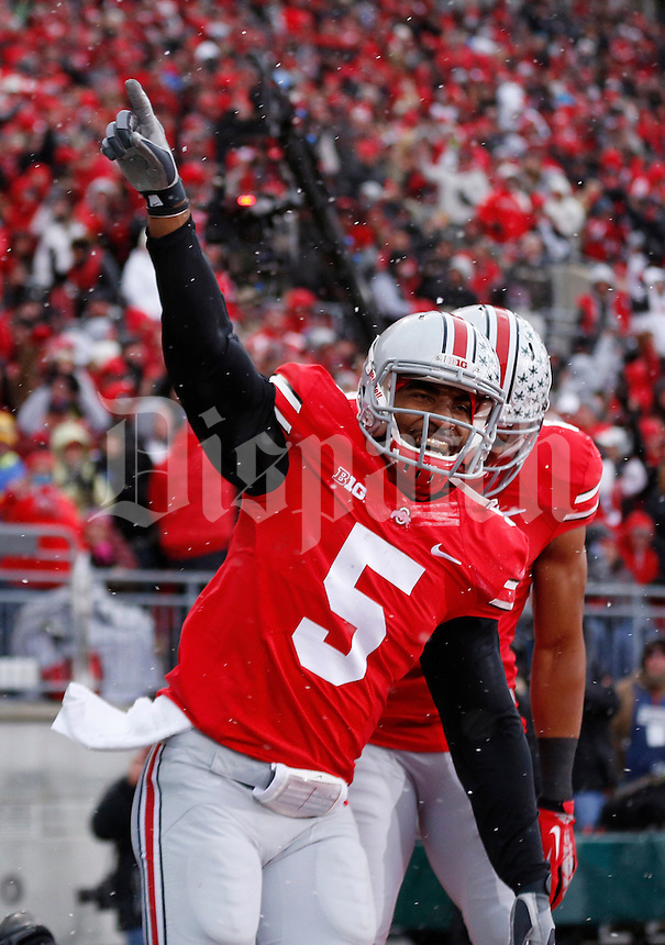 Ohio State Buckeyes quarterback Braxton Miller (5) reacts after running in a touchdown in the first quarter of the college football game between the Ohio State Buckeyes and the Indiana Hoosiers at Ohio Stadium in Columbus, Saturday afternoon, November 23, 2013. The Ohio State Buckeyes defeated the Indiana Hoosiers 42 - 14. (The Columbus Dispatch / Eamon Queeney)