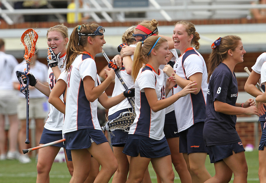 The University of Virginia women's lacrosse players celebrate the 14-12 victory over Towson during the first game since the tragic death of Virginia player Yeardley Love Sunday May 16, 2010 at Klockner Stadium in Charlottesville, Va. The Cavaliers rallied in the last four minutes to beat Towson and reach the quarter finals of the NCAA tournament. Love's body was found May 3, and Virginia men's lacrosse player George Huguely is charged with murder. Photo/Andrew Shurtleff..