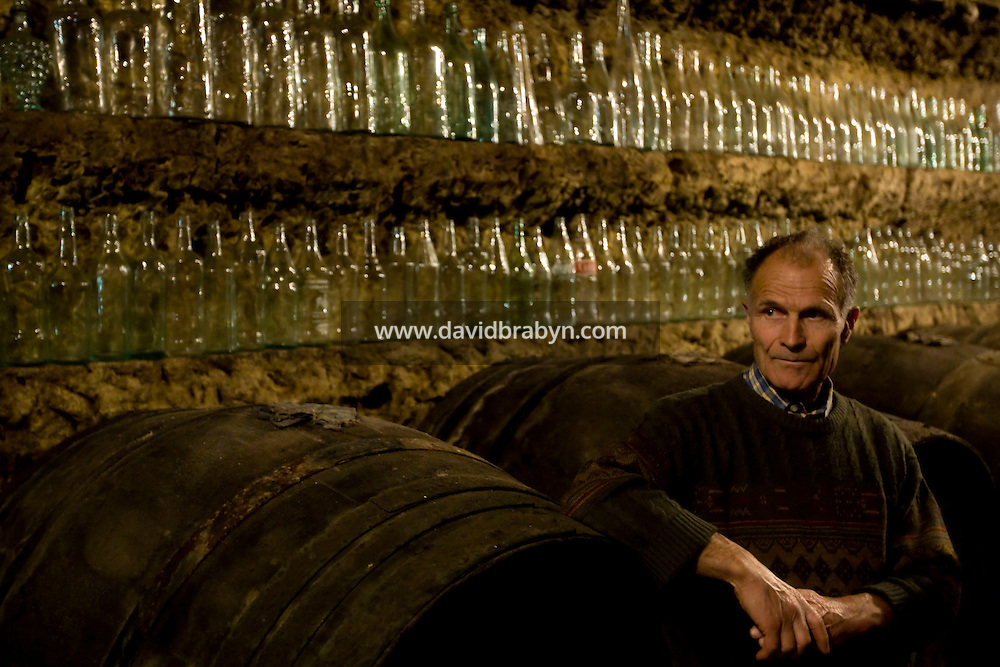 Winemaker Daniel Jarry stands by his collection of bottles in his cellars in Vouvray, France, 26 June 2008.