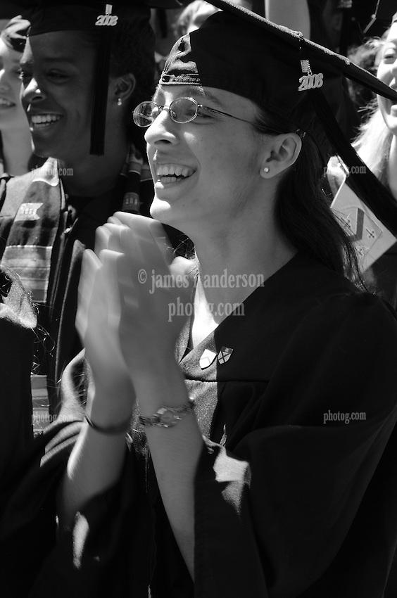 Gleeful anticipate to receiving her Degree at the 2008 Yale Commencement. Ceremonies on Old Campus, Yale University, New Haven, CT. Yale College Student Applauding and Smiling. In B&W and also available in Color. No model release.