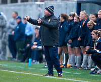 Georgetown head coach Dave Nolan talks to his team during the first round of the NCAA tournament at Shaw Field in Washington, DC.  Georgetown defeated La Salle, 2-0.