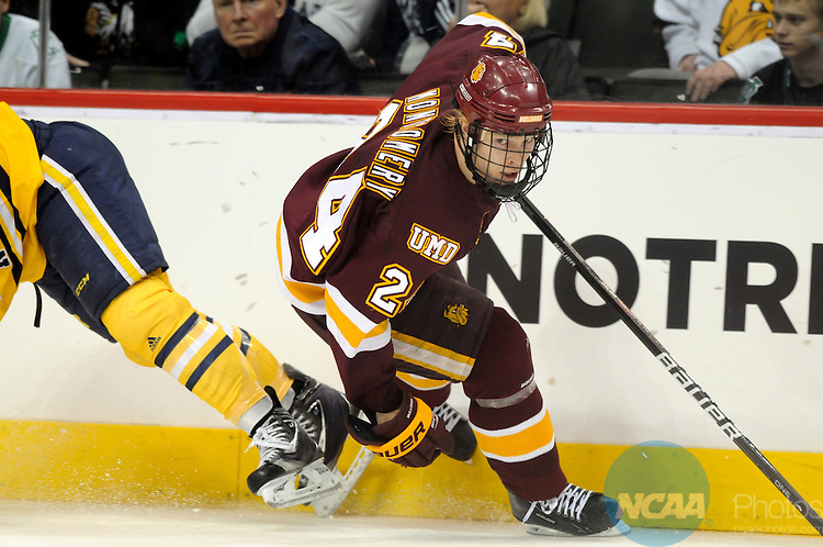 09 APR 2011: Mike Montgomery (24) of University of Minnesota looks down the ice during the Division I Men's Ice Hockey Championship held at the Xcel Energy Center in St. Paul, MN.  Minnesota-Duluth beat Michigan in overtime, 3-2 to claim the national title. Vince Muzik/NCAA Photos