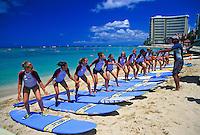 Vacationing high school girls learn the skills of surfing on Waikiki Beach