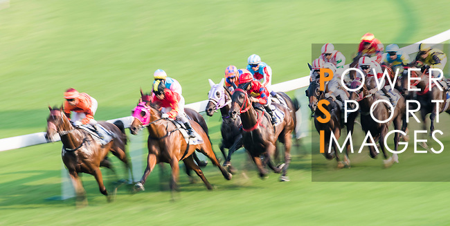Horse Fantastic Eight #4 ridden by Umberto Rispoli (orange cap) and horse Marvel Tribe #2 ridden by Keith Yeung Ming-lun (yellow/blue cap) compete during the race 8 of HKJC Horse Racing 2017-18 at the Sha Tin Racecourse on 16 September 2017 in Hong Kong, China. Photo by Victor Fraile / Power Sport Images