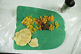 MAURITIUS, a Hindu eve of the wedding dinner is served and eaten by hand at the bride's home in the town of Surina