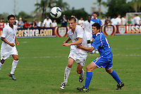 Dominick Sarle (10) of the USA and Mathias Cuadrado (4) of the Academy Select Team. The US U-17 Men's National Team defeated the Development Academy Select Team 5-3 during day two of the US Soccer Development Academy  Spring Showcase in Sarasota, FL, on May 23, 2009.