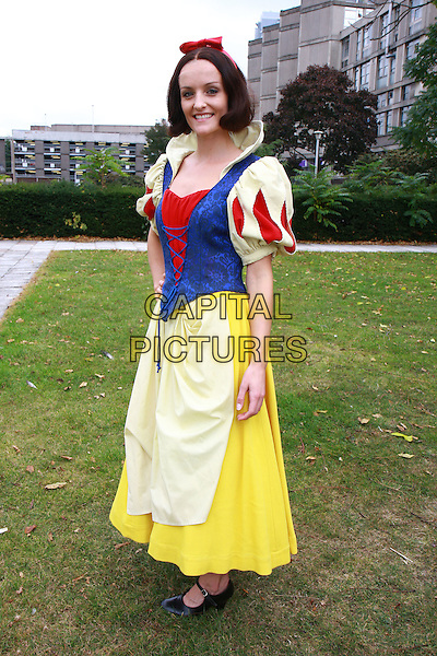 "KEAVY LYNCH.Cast photocall for ""Snow White and the Seven Dwarves"", Fairfields Hall, Croydon, England, UK, .30th September 2009..panto pantomime character dressed-up costume bow red velvet hairband hair band full length dress yellow blue.CAP/MAR.©Martin Harris/Capital Pictures"