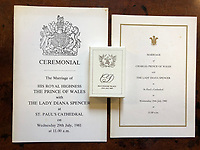 BNPS.co.uk (01202 558833)<br /> Pic: Charterhouse/BNPS<br /> <br /> The sale features a slice of wedding cake and an order of service from Charles and Diana's wedding in 1981.<br /> <br /> The fascinating archive of a longstanding member of staff to the Royal family has emerged for sale.<br /> <br /> It features a selection of Royal Christmas cards, including one from 2019, as well as a slice of wedding cake and an order of service from Charles and Diana's wedding in 1981.<br /> <br /> The vendor, who wishes to remain anonymous, is also selling their Royal 'personal service' medal and the menu and seat plan for a state banquet in 1980.<br /> <br /> They worked at Buckingham Palace from the late 70s to the beginning of the 21st century, receiving Christmas cards every year since as a token of their service.<br /> <br /> The collection is being sold with Charterhouse Auctioneers, of Sherborne, Dorset. It is expected to fetch £1,500.