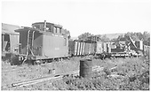RGS caboose #0400 on east side of Ridgway shop coupled to a coal car and another caboose, perhaps #0401 judging by the stencils.<br /> RGS  Ridgway, CO  Taken by Springer, Fred M. - 6/29/1951