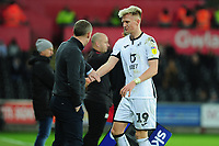 Steve Cooper Head Coach of Swansea City shakes hands with Sam Surridge of Swansea City during the Sky Bet Championship match between Swansea City and Barnsley at the Liberty Stadium in Swansea, Wales, UK. Sunday 29 December 2019