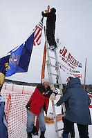 Volunteers at the start of the 2013 Junior Iditarod start on Knik Lake.  Knik Alaska..Photo by Jeff Schultz/IditarodPhotos.com   Reproduction prohibited without written permission
