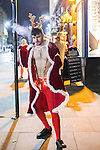 © Joel Goodman - 07973 332324 . 27/12/2016 . Wigan , UK . A man wearing a Christmas themed costume . Revellers in Wigan enjoy Boxing Day drinks and clubbing in Wigan Wallgate . In recent years a tradition has been established in which people go out wearing fancy-dress costumes on Boxing Day night . Photo credit : Joel Goodman