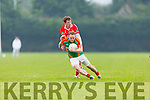 Darren O'Sullivan Mid kerry is tackled by Declan Ó Suileabhain West Kerry  during their County Championship clash in Beaufort on Saturday