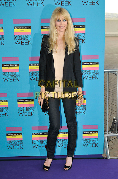 CLAUDIA SCHIFFER.Graduate Fashion Week 2009 Gala Show and Awards, Earls Court, London England, UK, June 10th 2009..full length black tuxedo blazer jacket clutch bag peep toe shoes skinny jeans denim beige top .CAP/PL.©Phil Loftus/Capital Pictures