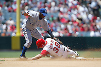 Esteban German of the Kansas City Royals tags out Robb Quinlan of  the Los Angeles Angels during a 2007 MLB season game at Angel Stadium in Anaheim, California. (Larry Goren/Four Seam Images)