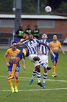 Jacob Mellis of Mansfield Town challenges Brandon Comley of Colchester United for the aerial ball during Colchester United vs Mansfield Town, Sky Bet EFL League 2 Football at the Weston Homes Community Stadium on 7th October 2017