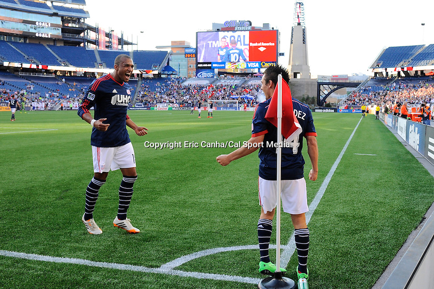 May 11, 2014 - Foxborough, Massachusetts, U.S. - hNew England Revolution forward Teal Bunbury (10) cheers on forward Diego Fagundez (14) for his goal during the MLS game between the Seattle Sounders FC and the New England Revolution held at Gillette Stadium in Foxborough Massachusetts. New England defeated Seattle 5-0   Eric Canha/CSM