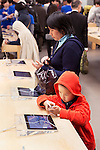 People trying new iPhones at Apple store in Ginza, Tokyo, Japan 2014