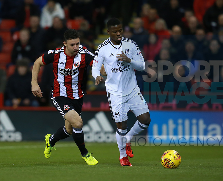 Enda Stevens of Sheffield Utd  chases Floyd Ayite of Fulham during the Championship match at Bramall Lane Stadium, Sheffield. Picture date 21st November 2017. Picture credit should read: Simon Bellis/Sportimage