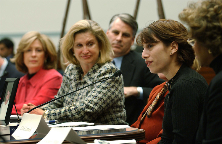 11/10/04.BRIEFING ON INTELLIGENCE REFORM CONFERENCE--Former Rep. Tim Roemer, D-Ind. (1991-2003), and a member of the Sept. 11 commission (in background), and Rep. Carolyn B. Maloney, D-N.Y., middle, with several family members of victims of the Sept. 11 attacks during a news conference on the intelligence reform conference. Sept. 11 family steering committee head Mary Fetchet is at left; family member Carie Lemack speaks. Family member Rosemary Dillard is at far right. From CQ.com: The family members, who come to Washington regularly to lobby for a bill that incorporates the recommendations of the Sept. 11 commission, blamed House Armed Services Chairman Duncan Hunter, R-Calif., as well as House Intelligence Committee Chairman Peter Hoekstra, R-Mich., for the conference stalemate..CONGRESSIONAL QUARTERLY PHOTO BY SCOTT J. FERRELL