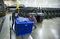 Julie Hall (left) and Vivki Penny with the Benton County Election Commission load voting machines and other equipment Thursday, Feb. 13, 2020, into a truck at the Benton County Election Commission office in Rogers. Staff began distributing equipment Thursday to the 36 vote centers for the March 3 primary election. Check out nwaonline.com/200214Daily/ for today's photo gallery.<br /> (NWA Democrat-Gazette/Ben Goff)