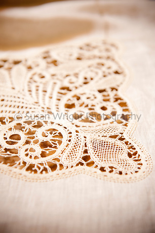 Pillow lace or bobbin lace ' Merletto a Tombolo' hand made from 100% linen thread.  Designs made for tablecloths, curtains and clothing, created in the medieval village of Anghiari, Tuscany, Italy.