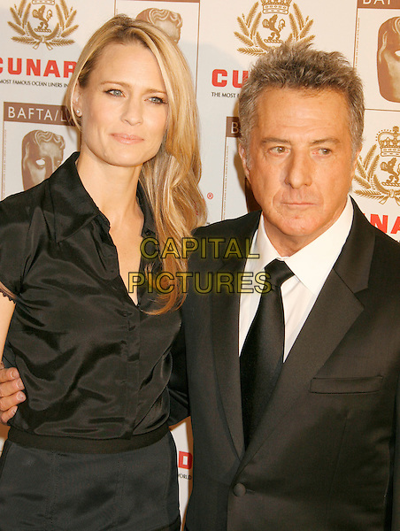 ROBIN WRIGHT PENN & DUSTIN HOFFMAN.The 2006 BAFTA/LA Cunard Britannia Awards held at the Century Plaza Hotel, Los Angeles, California, USA..November 2nd, 2006.Ref: ADM/RE.half length black dress suit jacket.www.capitalpictures.com.sales@capitalpictures.com.©Russ Elliot/AdMedia/Capital Pictures.