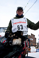 Lachlan Clarke arrives in Nome with a dog in the basket during the 2010 Iditarod