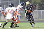 Palos Verdes, CA 09/22/11 - unknown Beverly Hills player(s) and Jordan Gates (Peninsula #9)) in action during the Beverly Hills-Peninsula Varsitty Football gane.