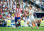 The Real Madrid Player Gareth Bale and the Atletico de Madrid playerThiago in a league football match in santiago Bernabeu stadium. 2014/09/13. Madrid. Spain. Samuel de Roman / Photocall3000