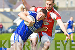 Kerins O'Rahillys Kieran O'Mahony is blocked by   Rathmore Conor O'Sullivan  in the Senior County League GAA Football Kerins O'Rahillys against Rathmore at Strand Road on Sunday