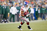 New York Giants tight end Travis Beckum (47) carries the ball during an NFL divisional playoff football game against the Green Bay Packers on January 15, 2012 in Green Bay, Wisconsin. The Giants won 37-20. (AP Photo/David Stluka)