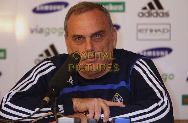 AVRAM GRANT .At Chelsea's press conference held at their Cobham training ground, England..April 13th, 2008.half length microhone black white striped stripes .CAP/DS.©Dudley Smith/Capital Pictures